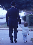 Man walking with a young child in Long Beach, NY