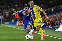 Eden Hazard of Chelsea chases down Tal Ben Haim II of Maccabi Tel-Aviv during the UEFA Champions League match between Chelsea and Maccabi Tel Aviv at Stamford Bridge, London, England on 16 September 2015. Photo by David Horn.