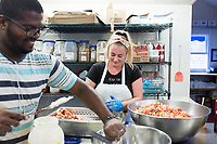 Rider Semedo, 27, of Cape Verde, (left) and Doris Mateljuk, 21, prepare meat for lobster rolls for the dinner service at Home Port restaurant in Chilmark/Menemsha, Martha's Vineyard, Massachusetts, USA, on Tues., July 25, 2017.  It is Semedo's first season working as a temporary worker on Martha's Vineyard. Mateljuk has a J1 visa for foreign students to temporarily work in the US. It's her second year working at the restaurant and she will return to Croatia in October. She studies occupational therapy. Home Port did not receive any H2B temporary foreign worker visas this year and has had difficulty filling all positions in the kitchen. On the day of this picture, one scheduled worker did not come to work and the restaurant could not find a backup to fill in. The restaurant has also quit serving lunch as a result of difficulty in finding workers.