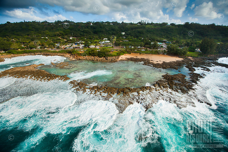 Waves rush towards Shark's Cove on O'ahu's North Shore.