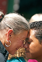 "A hongi is a traditional Māori greeting in New Zealand, done by pressing together the nose and forehead serves a similar purpose to a formal handshake. During the hongi the ha or ""breath of life"" is exchanged."