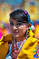 A girl dancer (danzante) takes part in the religious parade within the Corpus Christi festival in Pujilí, Ecuador, 1 June 2013. Every year in June, thousands of people gather in a small town of Pujili, high in the Andes, to celebrate the Catholic feast of Corpus Christi. Introduced originally during the Spanish conquest of South America, this celebration merges Catholic rituals of Holy Communion with the traditional Andean harvest and sun festivities (Inti, the Inca sun god). Women dancers perform wearing brightly colored costumes while men dancers wear chest ornaments and heavy elaborate headdresses adorned with mirrors, jewelry, or natural items (shells). Being a dancer in the Corpus Christi ceremonial parade (El Danzante) is considered an honour and a privilege by the indigenous people in Ecuador.