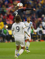 United's Taylor Kemp skies over LA's Alan Gordon to win the header. DC United defeated the LA Galaxy 1-0 with a stoppage time goal from Chris Pontius at RFK Stadium in Washington DC.