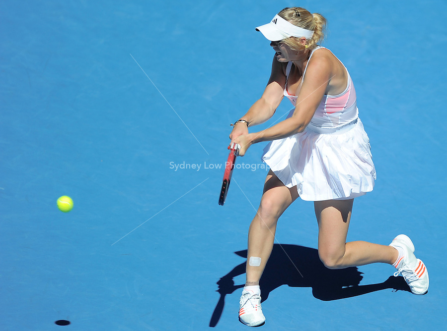 MELBOURNE, 27 JANUARY - Caroline Wozniacki (DEN) in action during her semi final match against Na Li (CHN) on day eleven of the 2011 Australian Open at Melbourne Park, Australia. (Photo Sydney Low / syd-low.com)