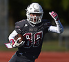 Anthony Paolino IV #88 of Mepham picks up yards after a catch in the second quarter of a Nassau County Conference II varsity football game against MacArthur at Mepham High School on Saturday, Oct. 20, 2018. Mepham won 35-34 in overtime.