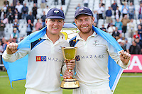 Picture by Alex Whitehead/SWpix.com - 12/09/2014 - Cricket - LV County Championship Div One - Nottinghamshire CCC v Yorkshire CCC, Day 4 - Trent Bridge, Nottingham, England - Yorkshire's Gary Ballance and Jonny Bairstow celebrate with the trophy.