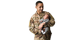 Studio portraits of an Army soldier father holding his new born son stock photo DOD complient rights managed model released