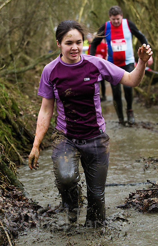 06 FEB 2011 - SIBBERTOFT, GBR - A competitor makes her way through the brook during the Avalanche Adventure Run .(PHOTO (C) NIGEL FARROW)