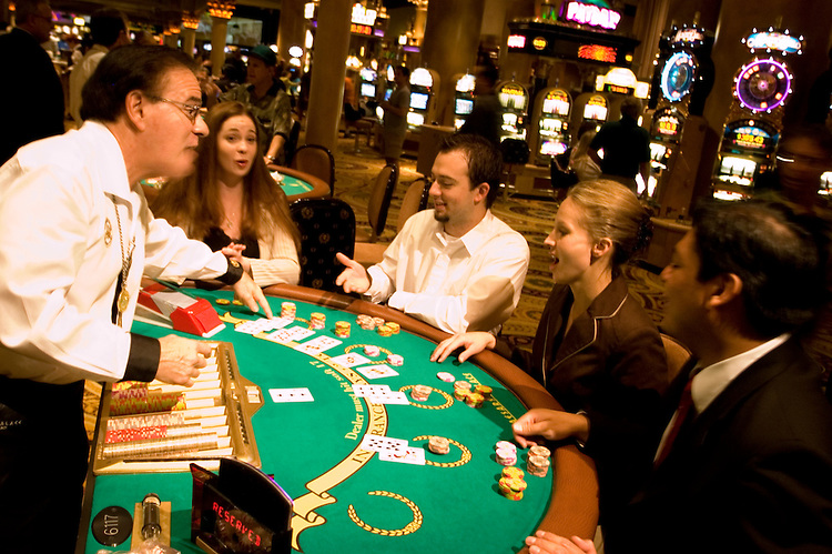 Blackjack table in Las Vegas, Nevada, Caesars Palace and Casino, gaming, gambling, chips, blackjack, betting croupier, blackjack players, model released, blackjack table, cards, NV, Las Vegas, Photo nv236-17149.Copyright: Lee Foster, www.fostertravel.com, 510-549-2202,lee@fostertravel.com