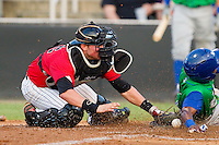 Terrance Gore (6) of the Lexington Legends slides across home plate ahead of the tag from Kannapolis Intimidators catcher Michael Marjama (12) at CMC-Northeast Stadium on July 29, 2013 in Kannapolis, North Carolina.  The Intimidators defeated the Legends 10-5.  (Brian Westerholt/Four Seam Images)