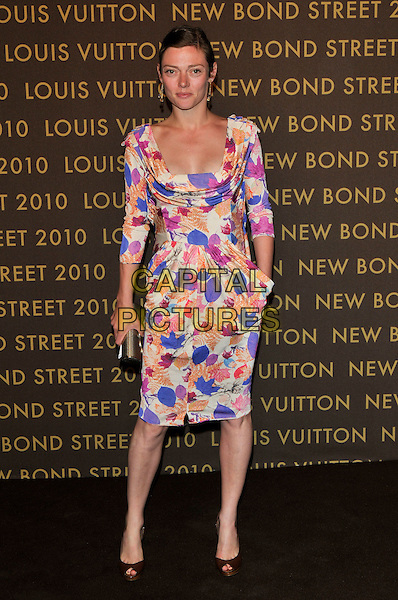 CAMILLA RUTHERFORD .attends the launch of the Louis Vuitton Bond Street Maison in London, England, UK, May 25th, 2010. .full length blue cream pink print dress long sleeve hand in pocket gold clutch bag peep toe shoes purple orange .CAP/PL.©Phil Loftus/Capital Pictures.