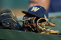 A Wingate Bulldogs cap sits on top of a glove on the roof of the visitors dugout during the game against the Catawba Indians at Newman Park on March 19, 2017 in Salisbury, North Carolina. The Indians defeated the Bulldogs 12-6. (Brian Westerholt/Four Seam Images)