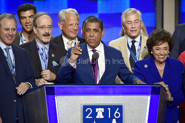 State Senator Adriano Espaillat (Democrat of New York) is surrounded by New York politicians as he makes remarks at the 2016 Democratic National Convention at the Wells Fargo Center in Philadelphia, Pennsylvania on Monday, July 25, 2016.<br /> Credit: Ron Sachs / CNP/MediaPunch<br /> (RESTRICTION: NO New York or New Jersey Newspapers or newspapers within a 75 mile radius of New York City)