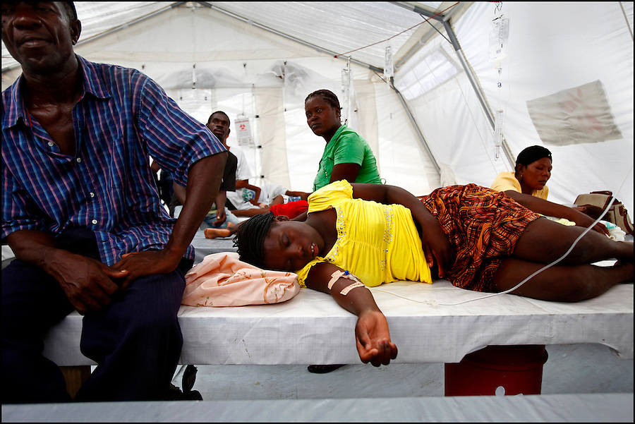 Nov 10, 2010 - Port-au-Prince, Haiti.Local residents suffering from cholera-like symptoms receive medical treatment in a small, crowded medical clinic set up in tents in the Cite Soleil area of Port-au-Prince, Haiti, Wednesday, November 10, 2010 as fears of a cholera outbreak spread through the area just two days after cases of the infection were confirmed in the area, the poorest slum in Haiti's capital. Officials from the Pan American Health Organization warn that Haiti's cholera epidemic, spread primarily through consuming infected water and food, is likely to grow much larger in the wake of Hurricane Tomas.  (Credit Image: Brian Blanco)
