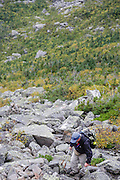 Hiker ascending the King Ravine Trail in King Ravine of the New Hampshire White Mountains.