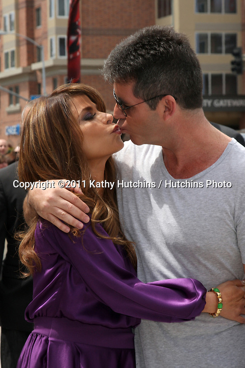 """LOS ANGELES - MAY 8:  Paula Abdul & Simon Cowell , two of the talent judges arriving at the """"X-Factor Auditions"""" at Galen Center on May 8, 2011 in Los Angeles, CA"""
