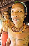 Portrait of Sikerei Agoy and his wife, shaman healers of Malagassat village, Siberut island, West Sumatra.