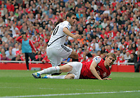 Pictured: Danny Graham of Swansea (TOP) tackled by Per Mertesacker of Arsenal. Saturday 10 September 2011<br /> Re: Premiership Arsenal v Swansea City FC at the Emirates Stadium, London.
