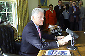In this photo released by the White House, United States President Bill Clinton delivers his live radio address to the nation from the Oval Office of the White House in Washington, DC on December 2, 2000.<br /> Mandatory Credit: Sharon Farmer / White House via CNP