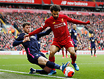 Jack Simpson of Bournemouth tackles Mohamed Salah of Liverpool during the Premier League match at Anfield, Liverpool. Picture date: 7th March 2020. Picture credit should read: Darren Staples/Sportimage