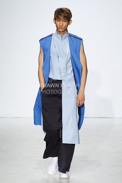 Model walks runway in an outfit from the General Idea Spring Summer 2018 collection by Bumuk Choi, at Skylight Clarkson Square on July 13, 2017; during New York Fashion Week: Men's Spring Summer 2018.