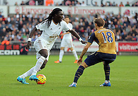 (L-R) Bafetimbi Gomis of Swansea attempts to get past Nacho Monreal of Arsenal during the Barclays Premier League match between Swansea City and Arsenal at the Liberty Stadium, Swansea on October 31st 2015