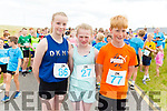Tara Ronan (Tralee Harriers), Evelyn Fitzgerald (Limerick) and Eoin O'Flaherty (St Brendans AC) ready to run for in the Banna 2k road race on Sunday morning.