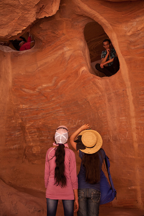 Caves in the Nubian Sandstone, line the narrow canyon of Petra in Jordan.
