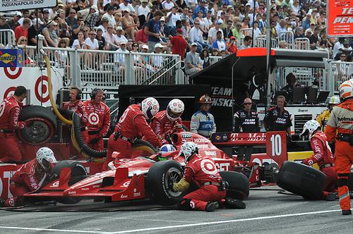 8-10 July, 2011, Toronto, Ontario CA<br /> Dario Franchitti pit stop.<br /> (c)2011, Paul Webb<br /> LAT Photo USA