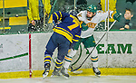 21 February 2015:  University of Vermont Catamount Defenseman Alexx Privitera, a Junior from Old Tappan, NJ, is checked by Merrimack College Warrior Defenseman Jonathan Lashyn, a Sophomore from Saskatoon, Saskatchewan, in the second period at Gutterson Fieldhouse in Burlington, Vermont. The teams played to a scoreless tie as the Cats wrapped up their Hockey East regular home season. Mandatory Credit: Ed Wolfstein Photo *** RAW (NEF) Image File Available ***