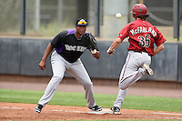 Colorado Rockies first baseman Henry Garcia (33) waits for a throw as Dane McFarland (45) reaches the bag during an Instructional League game against the Arizona Diamondbacks on October 8, 2014 at Salt River Fields at Talking Stick in Scottsdale, Arizona.  (Mike Janes/Four Seam Images)