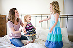 Author Tasha Blaine plays with her two children in her Sacramento, Calif. home May 25, 2009.