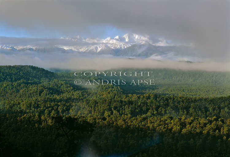 The Southern Alps through cloud and mist. Westland National Park. New Zealand.
