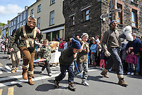 6-5-2012: SUNDAY: Nick Massett aka Tom Crean and his 'huskies'  march through the streets of Dingle in County Kerry on Sunday  during  the annual Dingle Feile na Bealtaine Festival parade which had the theme of 'Tom Crean-Antartic Explorer' featuring explorers,  icebergs, penguins, huskies, whales and musicians.  The festival finishes on Monday with a political symposium entitled 'Can We Re-Pay Our Way' at the Blasket Centre in Dun Chaoin.<br /> Picture by Don MacMonagle