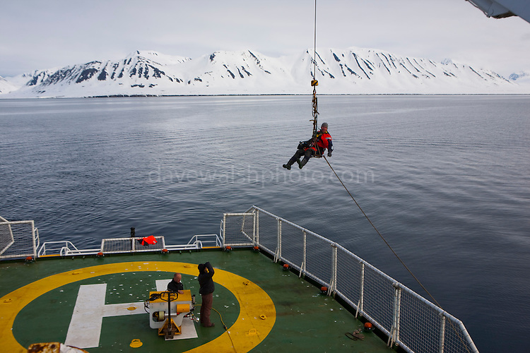 Videographer Jari Stahl on the Esperanza Crane, in Woodfjorden, Svalbard, Arctic Under Pressure expedition 2010