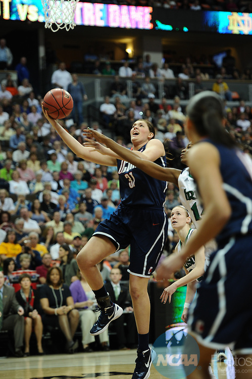 01 APRIL 2012:  Center Stefanie Dolson of UCONN (31) goes up for a shot against Notre Dame during the Division I Women's Final Four semifinals at the Pepsi Center in Denver, CO.  Stephen Nowland/NCAA Photos