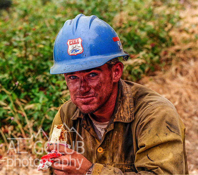 August 25, 1999 Buck Meadows, California -- Pilot Fire – Pike Hotshot pauses for a bite to eat. The Pilot Fire burned 3,300 acres in the Tuolumne River Canyon near Yosemite National Park. The fire burned across the Hetch Hetchy power lines.