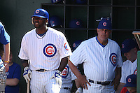 MESA, AZ - FEBRUARY 26:  Portrait of Milton Bradley of the Chicago Cubs as manager Lou Piniella (right) looks at him in the dugout during their spring training game against the Milwaukee Brewers at HoHoKam Park in Mesa, Arizona on February 26, 2009.  Photo by Brad Mangin