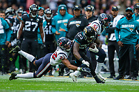 3rd November 2019; Wembley Stadium, London, England; National Football League, Houston Texans versus Jacksonville Jaguars; Running Back Ryquell Armstead of Jacksonville Jaguars is tackled by Defensive Back Gareon Conley of Houston Texans - Editorial Use
