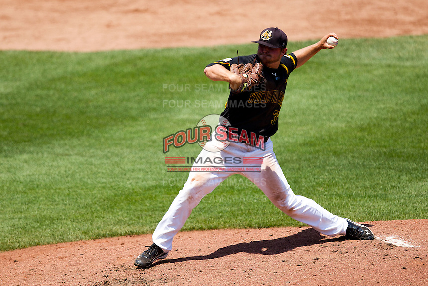 Albert Minnis (33) of the Wichita State Shockers delivers a pitch during a game against the Missouri State Bears in the 2012 Missouri Valley Conference Championship Tournament at Hammons Field on May 23, 2012 in Springfield, Missouri. (David Welker/Four Seam Images)