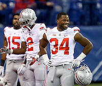 Ohio State Buckeyes running back Carlos Hyde (34) is all smiles prior to the first half of the Big Ten Championship football game at Lucas Oil Stadium in Indianapolis on Friday, December 7, 2013. (Columbus Dispatch photo by Jonathan Quilter)
