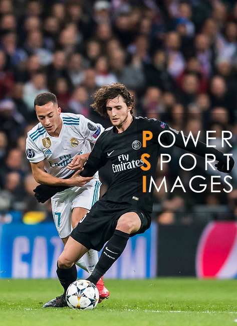 Adrien Rabiot (R) of Paris Saint Germain fights for the ball with Lucas Vazquez of Real Madrid during the UEFA Champions League 2017-18 Round of 16 (1st leg) match between Real Madrid vs Paris Saint Germain at Estadio Santiago Bernabeu on February 14 2018 in Madrid, Spain. Photo by Diego Souto / Power Sport Images