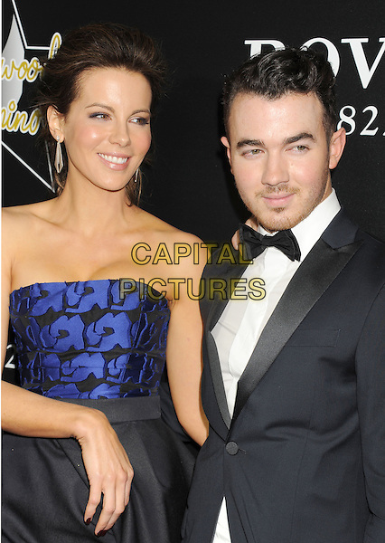 HOLLYWOOD, CA- FEBRUARY 27: Actress Kate Beckinsale (L) and musician Kevin Jonas arrive at the Hollywood Domino's 7th Annual Pre-Oscar Charity Gala at Sunset Tower on February 27, 2014 in West Hollywood, California.<br /> CAP/ROT/TM<br /> &copy;Tony Michaels/Roth Stock/Capital Pictures