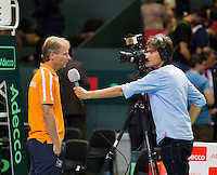 Switserland, Genève, September 18, 2015, Tennis,   Davis Cup, Switserland-Netherlands, Dutch Captain Jan Siemerink is interviewed by Jan-Willem de Lange of Sport 1 TV<br /> Photo: Tennisimages/Henk Koster
