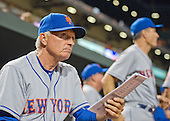 New York Mets manager Terry Collins (10) checks his line-up card in the ninth inning against the Baltimore Orioles at Oriole Park at Camden Yards in Baltimore, Maryland on Wednesday, August 19, 2015.  The Orioles won the game 5 - 4.<br /> Credit: Ron Sachs / CNP<br /> (RESTRICTION: NO New York or New Jersey Newspapers or newspapers within a 75 mile radius of New York City)