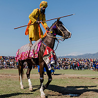 ANANDPUR SAHIB, INDIA - March 06, 2015: A Nihangs, or &quot;Sikh warrior&quot; participates in a horse riding competition during Hola Mohalla celebrations on March 06, 2015 in Anandpur Sahib, India. Hola Mahalla or simply Hola is a Sikh event, which takes place on the first of the lunar month of Chet, which usually falls in March, and sometimes coincides with the Sikh New Year. It was started by Guru Gobind Singh the tenth Sikh guru in 1701 AD. Hola Mohalla is a three day Sikh festival, in which Nihang Sikh 'warriors' perform Gatka (mock encounters with real weapons), tent pegging and bareback horse-riding, which usually falls in March coinciding with or following the Hindu festival of Holi. <br /> Daniel Berehulak for The New York Times