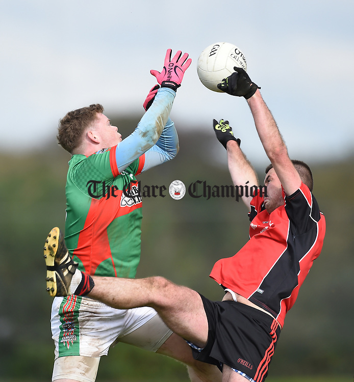 Keith Sexton of Kilmurry Ibrickane  in action against Sean O Connor of Meelick during their Junior A  county final at Gurteen. Photograph by John Kelly.