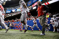 Ohio State Buckeyes head coach Urban Meyer takes the field with his team for warm-ups prior to the Allstate Sugar Bowl college football playoff semifinal against the Alabama Crimson Tide at the Mercedes-Benz Superdome in New Orleans on Jan. 1, 2015. (Adam Cairns / The Columbus Dispatch)