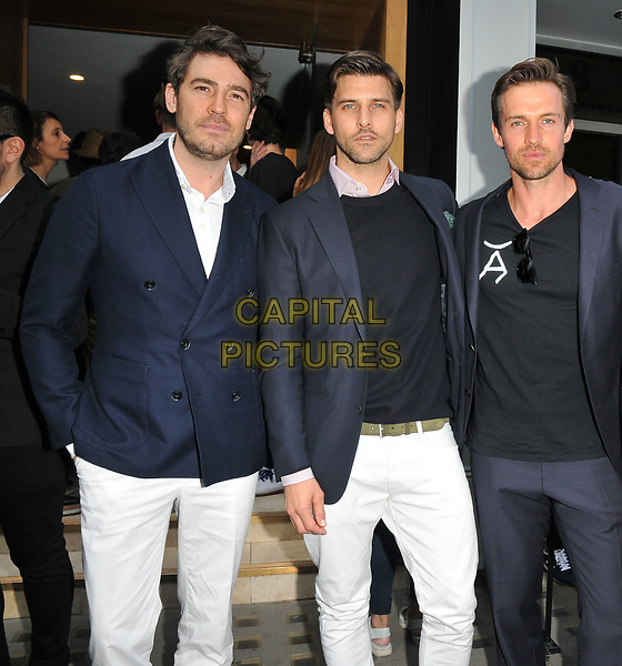 Robert Konjic, Johannes Huebl, Andrew Cooper at the LFW (Men's) s/s 2018 Aston Martin x Hogan cocktail party, Aston Martin, Dover Street, London, England, UK, on Sunday 11 June 2017.<br /> CAP/CAN<br /> &copy;CAN/Capital Pictures