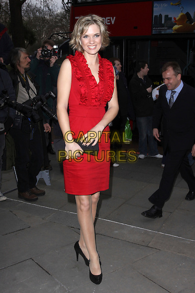 CHARLOTTE BINGHAM.The TRIC Awards 2010 (Television and Radio Industries Club) held at the Grosvenor hotel - outside arrivals London, England, UK, March 9th 2010..arrivals full length red sleeveless dress black shoes clutch bag ruffles ruffle neck .CAP/AH.©Adam Houghton/Capital Pictures.